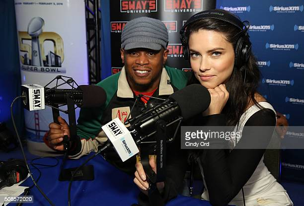 Model Adriana Lima visits SiriusXM host Sway Calloway at the SiriusXM set at Super Bowl 50 Radio Row at the Moscone Center on February 5 2016 in San...