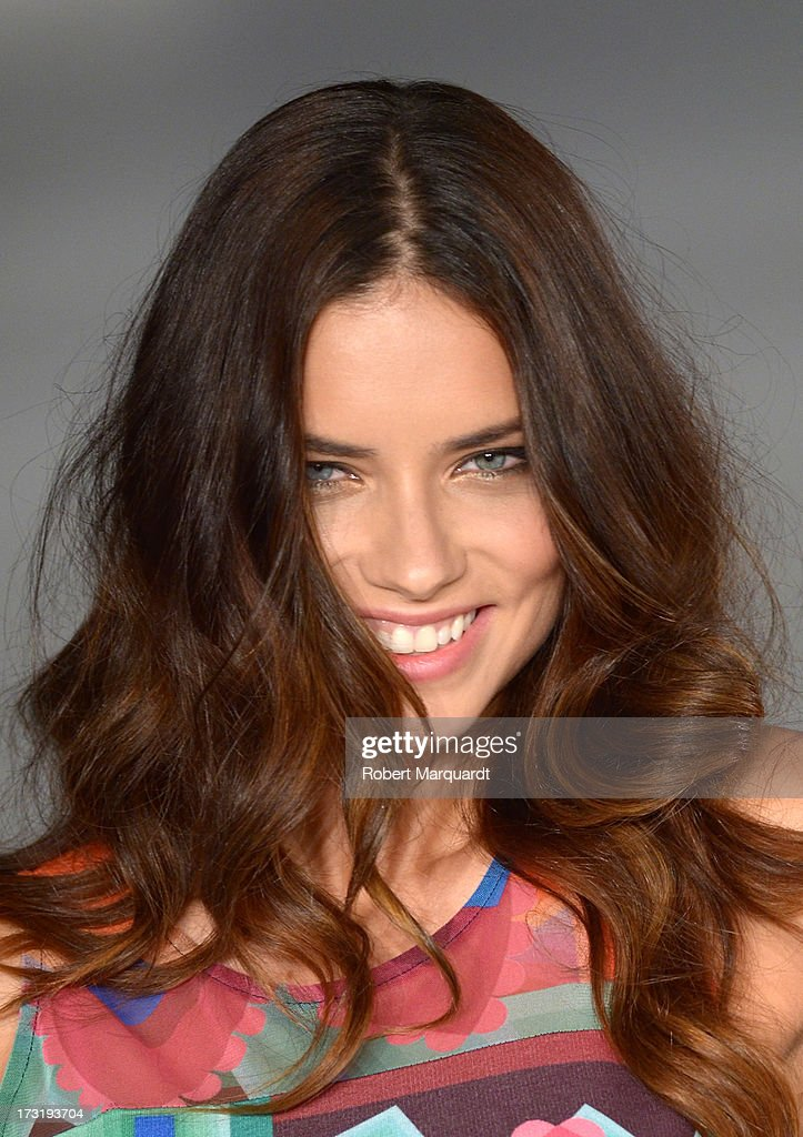 Model <a gi-track='captionPersonalityLinkClicked' href=/galleries/search?phrase=Adriana+Lima&family=editorial&specificpeople=182444 ng-click='$event.stopPropagation()'>Adriana Lima</a> walks the runway at Desigual's Spring-Summer 2014 Collection 'For Everybody: Sex, Fun & Love' during 080 Barcelona Fashion Week on July 9, 2013 in Barcelona, Spain.
