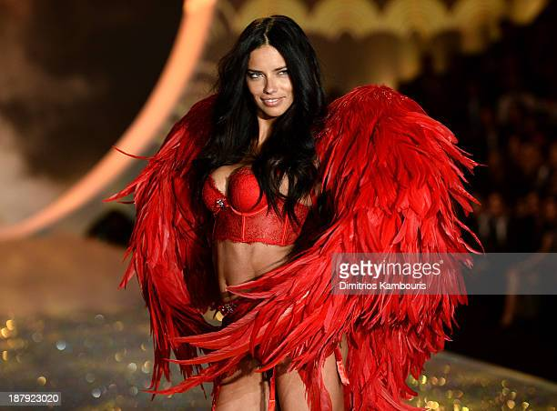Model Adriana Lima walks the runway at the 2013 Victoria's Secret Fashion Show at Lexington Avenue Armory on November 13 2013 in New York City