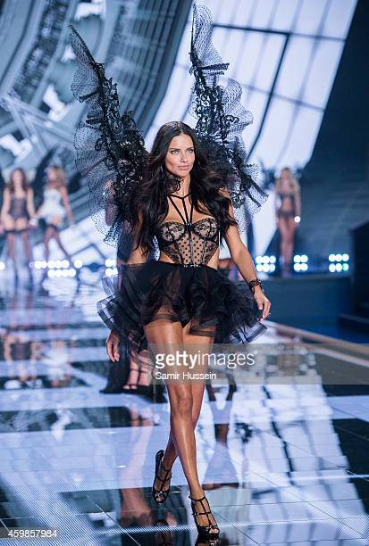 Model Adriana Lima walks the runway at the annual Victoria's Secret fashion show at Earls Court on December 2 2014 in London England