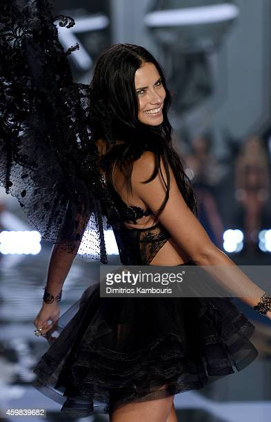 Model Adriana Lima walks the runway during the 2014 Victoria's Secret Fashion Show at Earl's Court Exhibition Centre on December 2 2014 in London...