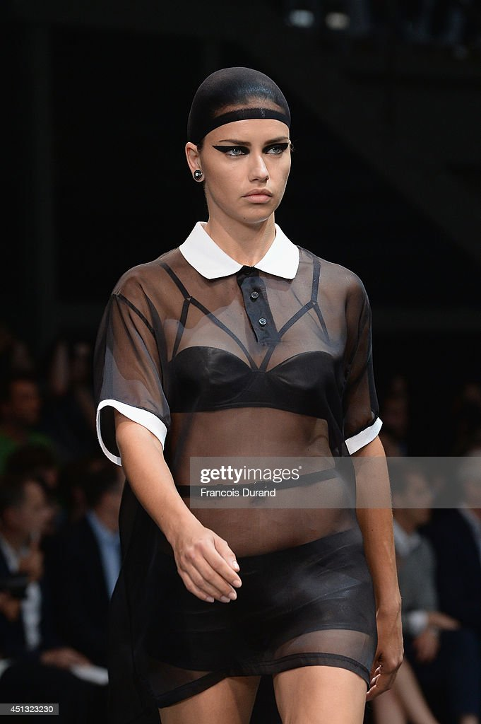 Model <a gi-track='captionPersonalityLinkClicked' href=/galleries/search?phrase=Adriana+Lima&family=editorial&specificpeople=182444 ng-click='$event.stopPropagation()'>Adriana Lima</a> walks the runway during the Givenchy show as part of the Paris Fashion Week Menswear Spring/Summer 2015 on June 27, 2014 in Paris, France.