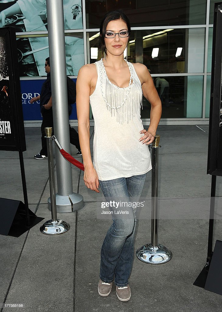 Model <a gi-track='captionPersonalityLinkClicked' href=/galleries/search?phrase=Adrianne+Curry&family=editorial&specificpeople=715970 ng-click='$event.stopPropagation()'>Adrianne Curry</a> attends the premiere of 'The Grandmaster' at ArcLight Cinemas on August 22, 2013 in Hollywood, California.