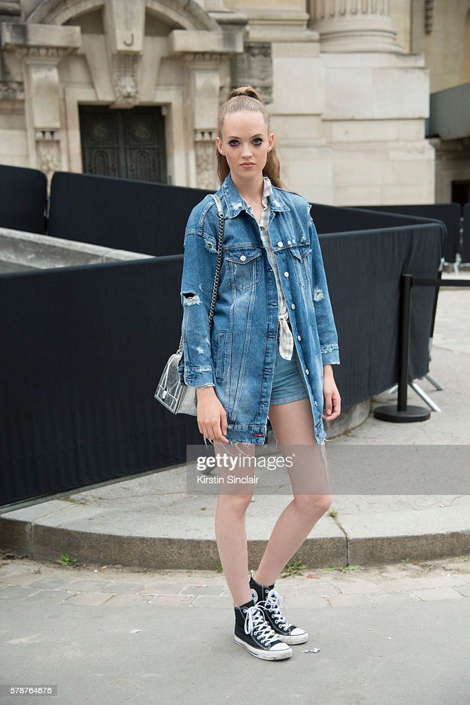 Model Adrienne Jüliger wears a Hollister shirt Zara jacket Levi'u2019s shorts Converse sneakers and Dior bag on day 3 of Paris Haute Couture Fashion...