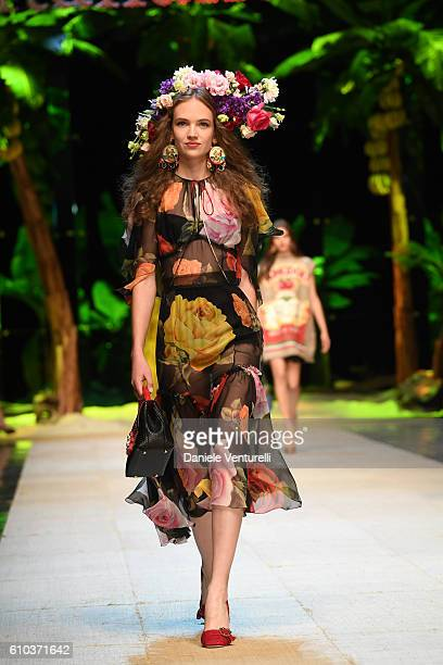 Model Adrienne Jueliger walks the runway at the Dolce And Gabbana show during Milan Fashion Week Spring/Summer 2017 on September 25 2016 in Milan...