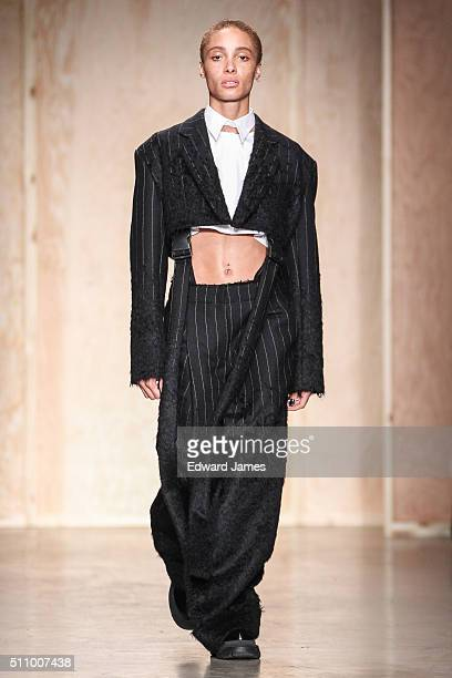 Model Adwoa Aboah walks the runway during the DKNY fashion show at Skylight Modern on February 17 2016 in New York City