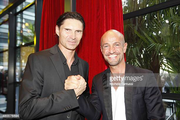 Model Agent Peyman Amin poses with Thomas Brdaric former football player during the opening ceremony at the Kameha Hotel on August 28 2015 in Zurich...