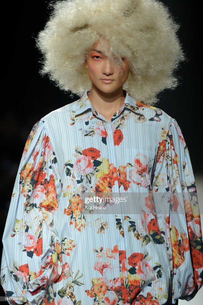 Model Ai Tominaga showcases designs during the DRESSCAMP runway as part of Mercedes Benz Fashion Week TOKYO 2014 S/S at the Hikarie A hall of Shibuya Hikarie on October 15, 2013 in Tokyo, Japan.