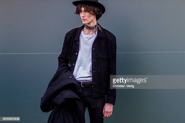 Model Akos Sogor outside Etro during Milan Men's Fashion Week Fall/Winter 2016/17 on January 18 in Milan Italy