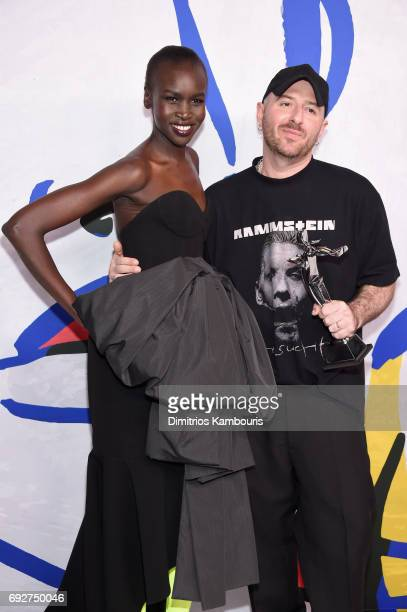 Model Alek Wek and designer Demna Gvasalia for Vetements and Balenciaga poses with International Award on the Winners Walk during 2017 CFDA Fashion...