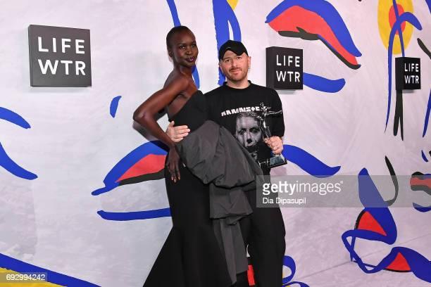 Model Alek Wek and International Award Winner Demna Gvasalia for Vetements and Balenciaga pose on the LIFEWTR Winner's Walk at the CFDA Awards 2017...