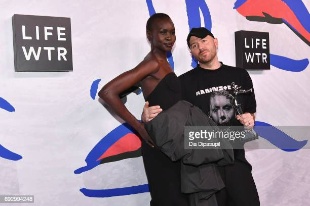 Model Alek Wek and International Award Winner Demna Gvasalia for Vetements and Balenciaga pose on the LIFEWTR Winner's Walk at the CFDA Awards 2017...