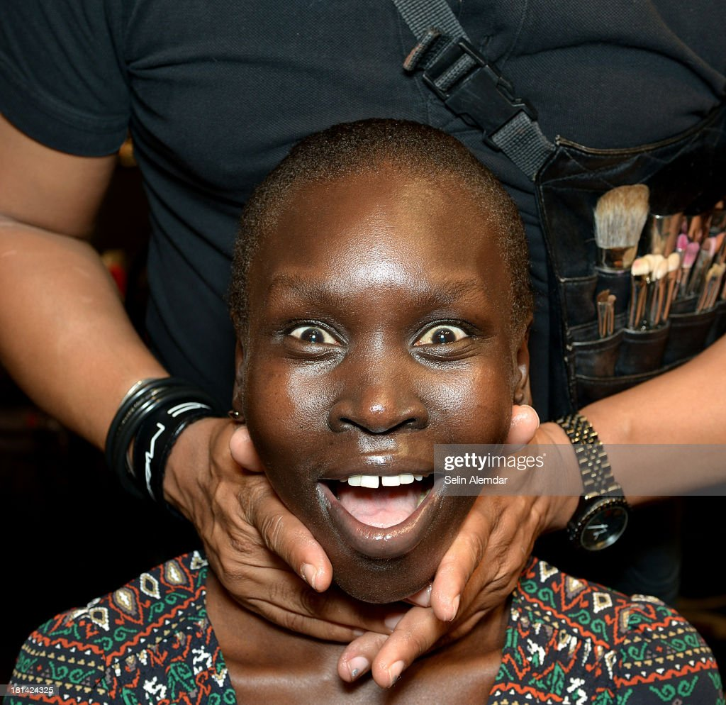 Model <a gi-track='captionPersonalityLinkClicked' href=/galleries/search?phrase=Alek+Wek&family=editorial&specificpeople=239513 ng-click='$event.stopPropagation()'>Alek Wek</a> prepares backstage ahead of the Ermanno Scervino Runway show as a part of Milan Fashion Week Womenswear Spring/Summer 2014 on September 21, 2013 in Milan, Italy.