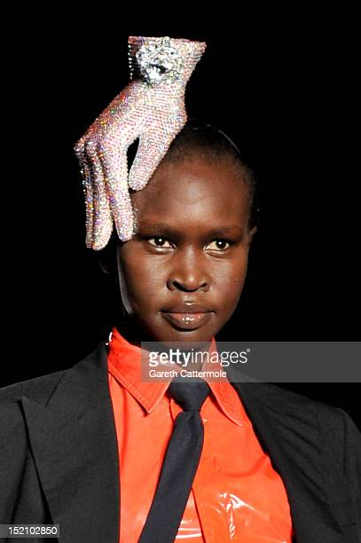 Model Alek Wek showcases designs on the catwalk by Philip Treacy on day 3 of London Fashion Week Spring/Summer 2013 at The Royal Courts Of Justice on...