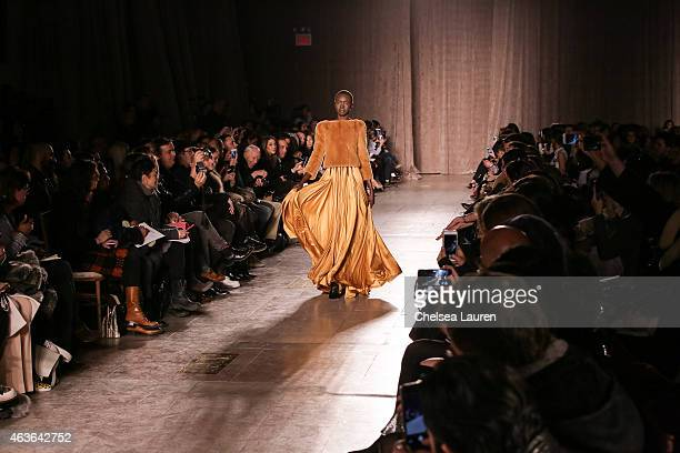 Model Alek Wek walks the runway during the Zac Posen fashion show at Vanderbilt Hall at Grand Central Terminal on February 16 2015 in New York City