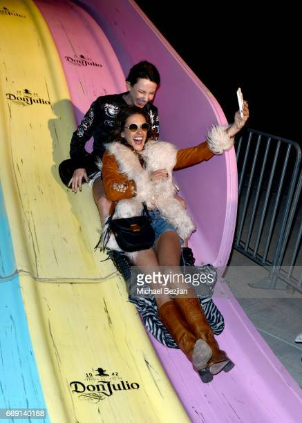 Model Alessandra Ambrosio and guest attend The Levi's Brand Presents NEON CARNIVAL with Tequila Don Julio on April 15 2017 in Thermal California
