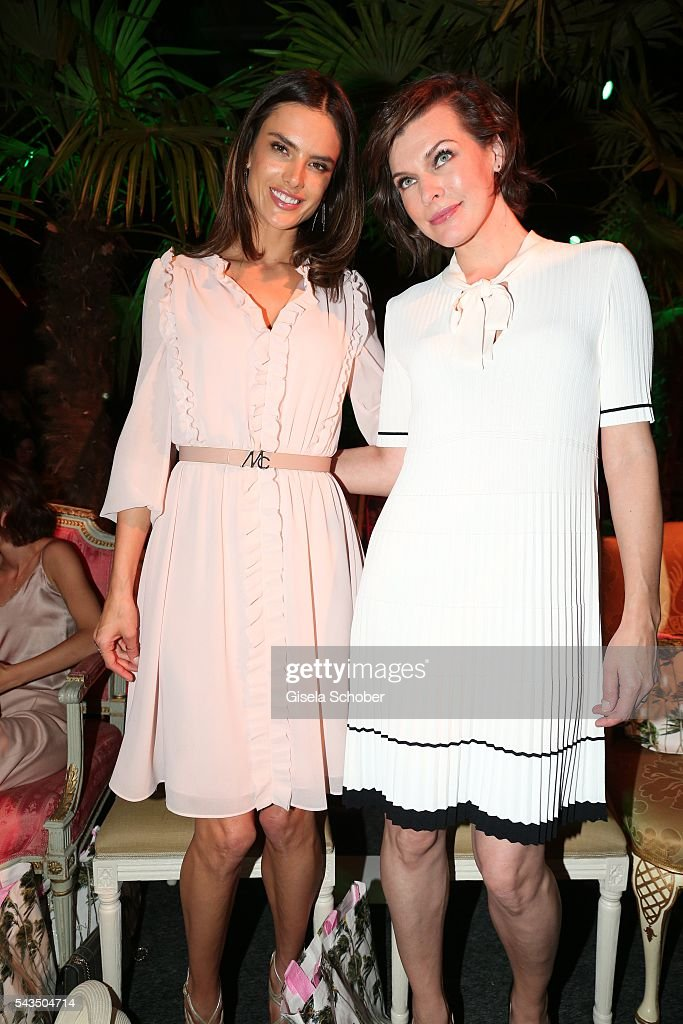 Model Alessandra Ambrosio and Milla Jovovich during the Marc Cain fashion show spring/summer 2017 at CITY CUBE Panorama Bar on June 28, 2016 in Berlin, Germany.