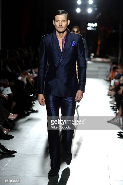 Model Alex Lundqvist walks the runway during the 2nd Annual amfAR Inspiration Gala at The Museum of Modern Art on June 14 2011 in New York City