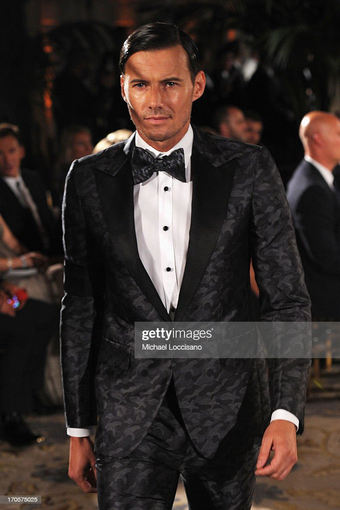 Model Alex Lundqvist walks the runway during the 4th Annual amfAR Inspiration Gala New York at The Plaza Hotel on June 13, 2013 in New York City.