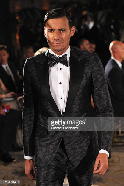 Model Alex Lundqvist walks the runway during the 4th Annual amfAR Inspiration Gala New York at The Plaza Hotel on June 13 2013 in New York City