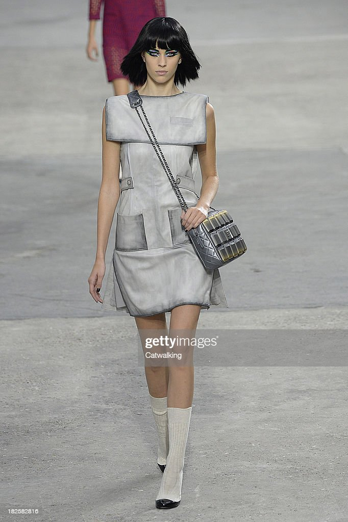 Model Alexa Chung walks the runway at the Chanel Spring Summer 2014 fashion show during Paris Fashion Week on October 1, 2013 in Paris, France.
