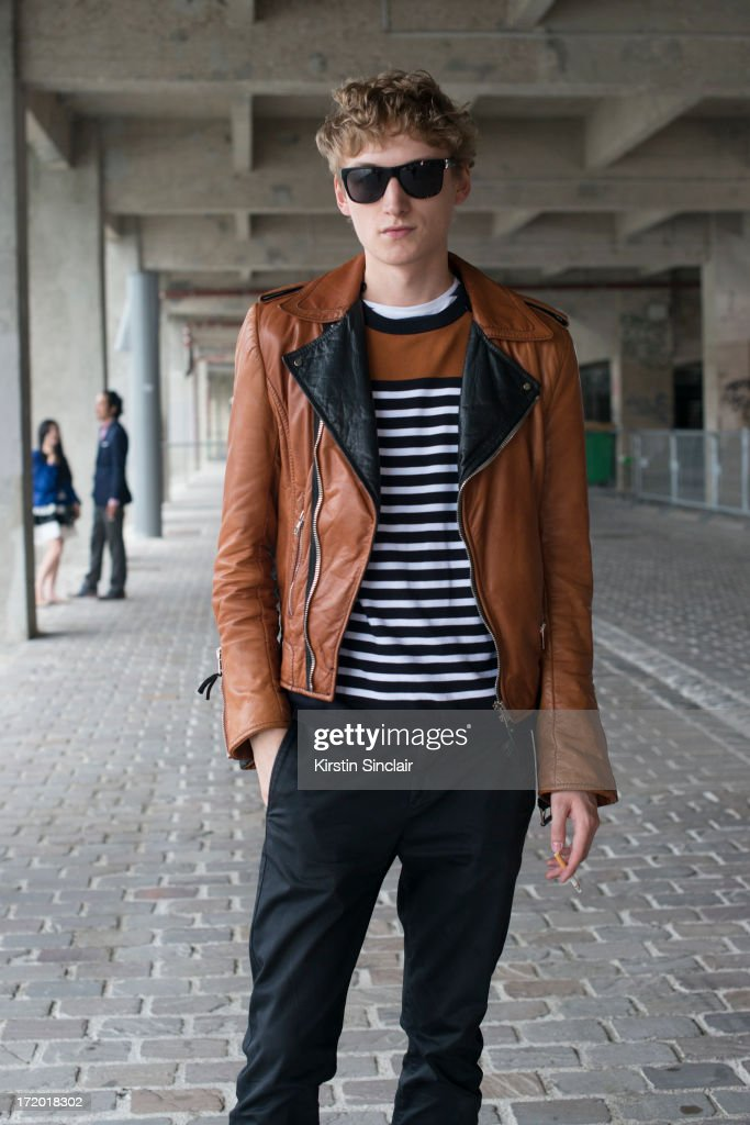 Model Alexander Laible wears a Balenciaga jacket, Cos sweater, Lanvin belt, Acne jeans and Burberry sunglasses on day 3 of Paris Collections: Men on June 28, 2013 in Paris, France.