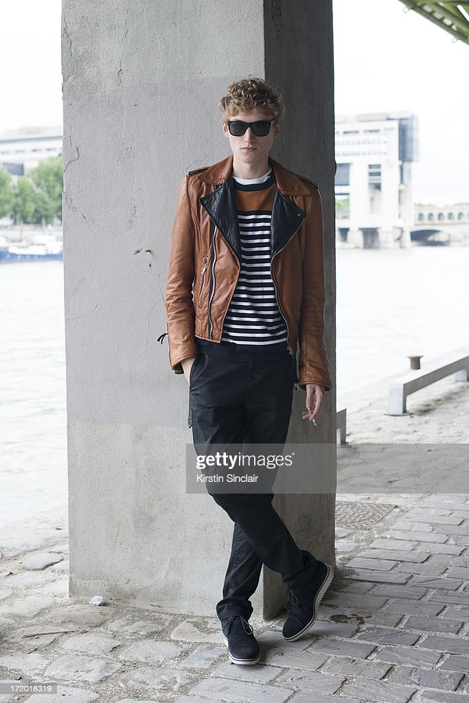 Model Alexander Laible wears a Balenciaga jacket, Cos sweater, Lanvin belt, Acne jeans, Saint Laurent shoes and Burberry sunglasses on day 3 of Paris Collections: Men on June 28, 2013 in Paris, France.