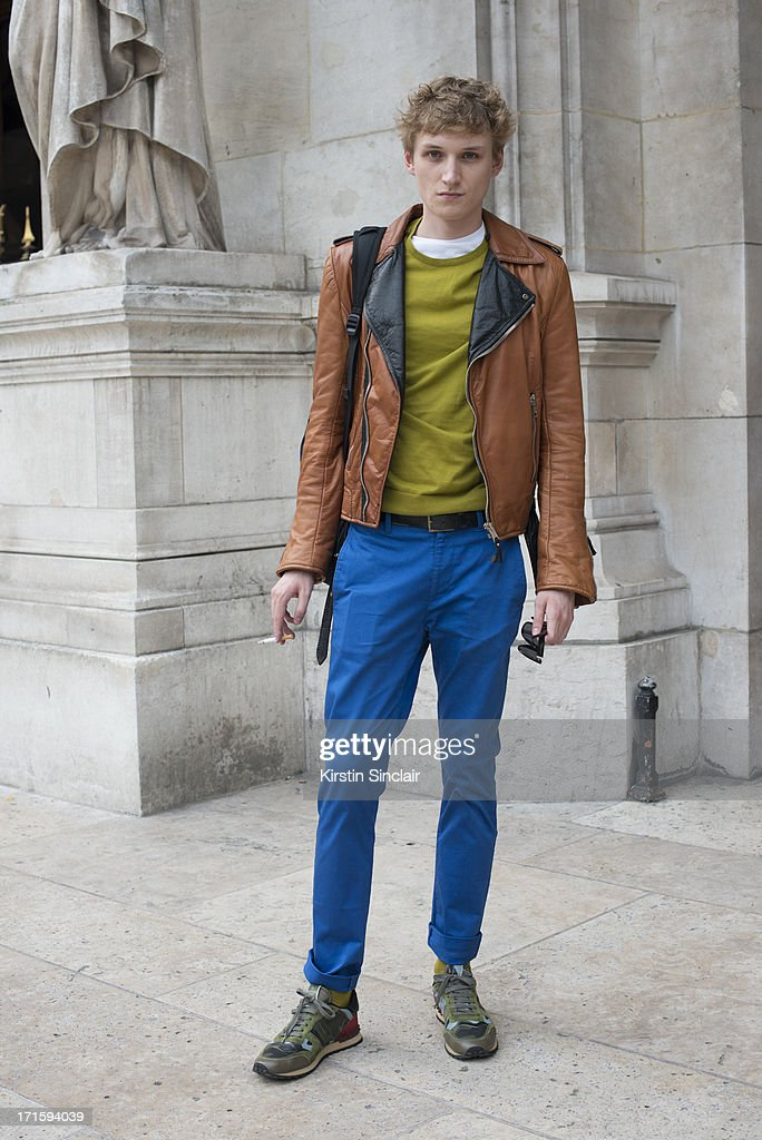 Model Alexander Laible wears Valentino trainers, Acne trousers, Cos sweater and a vintage Balenciaga jacket on day 1 of Paris Collections: Men on June 26, 2013 in Paris, France.