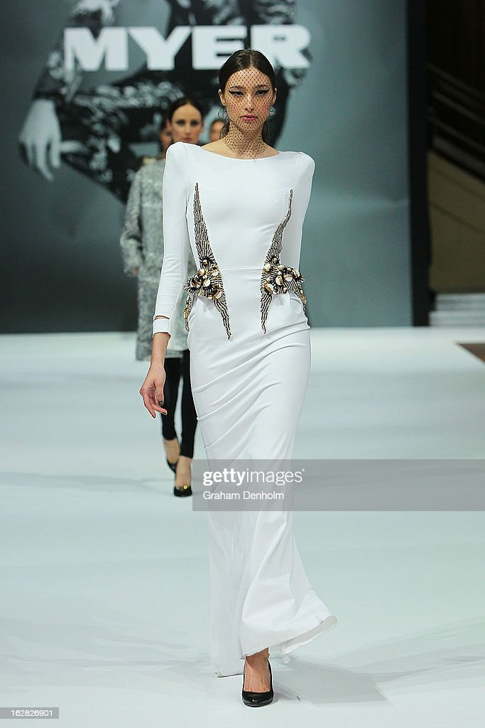 Model Alexandra Agoston showcases designs by Toni Maticevski at the Myer Autumn/Winter 2013 collections launch at Mural Hall at Myer on February 28, 2013 in Melbourne, Australia.