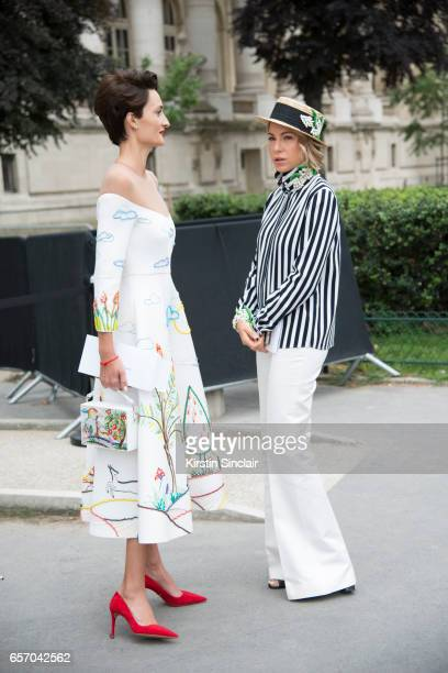 Model Alexandra Sergienko wears an Alexander Arutyunov dress and bag and Prada shoes with Cosmetic brand owner Anna Kovalchuk who wears an Alexander...