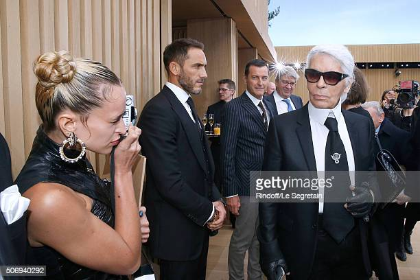 Model Alice Dellal takes Stylist Karl Lagerfeld in pictures after the Chanel Spring Summer 2016 show as part of Paris Fashion Week on January 26 2016...