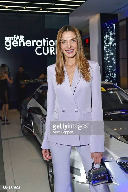 Model Alina Baikova attends the 2017 amfAR generationCURE Holiday Party on December 1 2017 in New York City