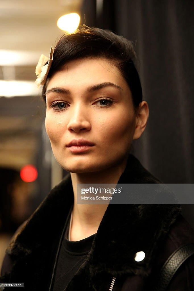 Model Alina Tatsiy prepares backstage at Taoray Wang fashion show during Fall 2016 New York Fashion Week: The Shows at The Dock, Skylight at Moynihan Station on February 13, 2016 in New York City.