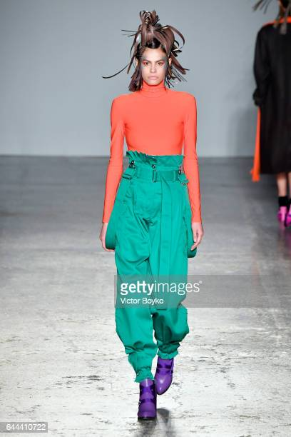 Model Alisar Ailabouni walks the runway at the Atsushi Nakashima show during Milan Fashion Week Fall/Winter 2017/18 on February 23 2017 in Milan Italy