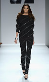 Model Alisar Ailabouni walks the runway at the Mark And Estel fashion show during MercedesBenz Fashion Week Spring 2014 at The Studio at Lincoln...