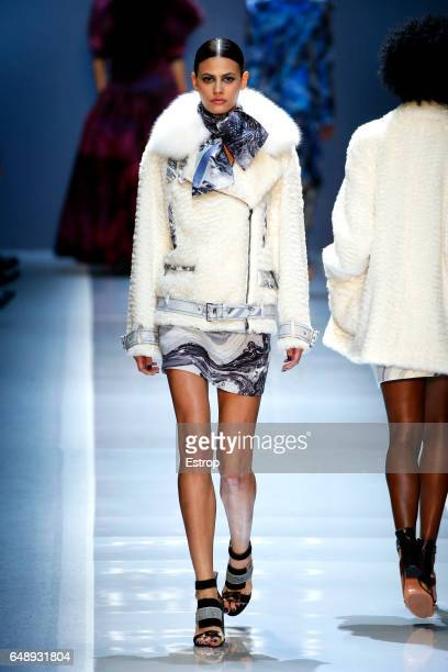 Model Alisar Ailabouni walks the runway during the Leonard Paris designed by Yiqing Yin show as part of the Paris Fashion Week Womenswear Fall/Winter...