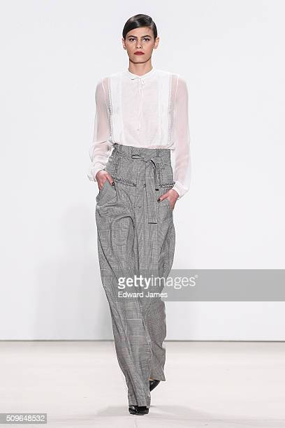 Model Alisar Ailabouni walks the runway during the Marissa Webb fashion show at The Gallery Skylight at Clarkson Sq on February 11 2016 in New York...