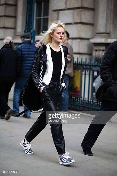Model Aly Turska wears Zara Adidas sneakers Off White backpack and MoCo white cardigan during London Fashion Week Fall/Winter 2015/16 at Somerset...