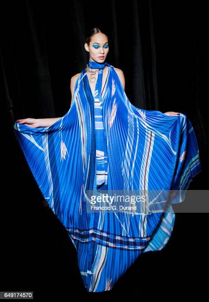 Model Amanda Harvey poses backstage before the Leonard Paris show as part of the Paris Fashion Week Womenswear Fall/Winter 2017/2018 on March 6 2017...