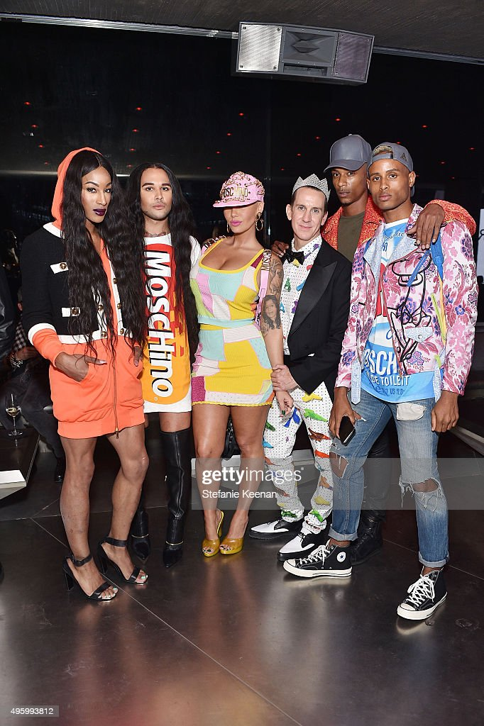 Model Amber Rose (C) and designer Jeremy Scott attend Jeremy Scott For Longchamp 10th Anniversary held at a Private Residence on November 5, 2015 in Beverly Hills, California.