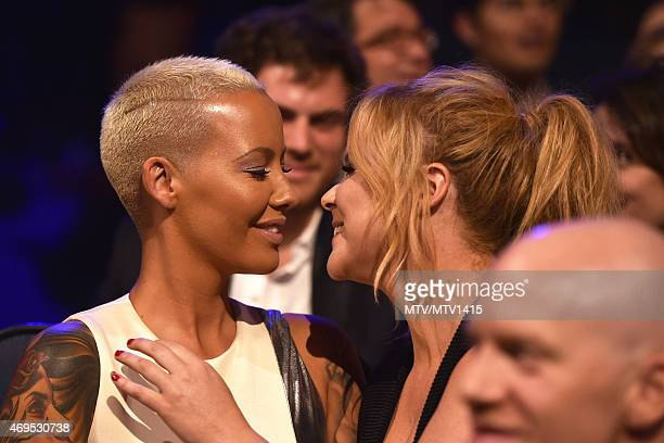 Model Amber Rose and host Amy Schumer attendsThe 2015 MTV Movie Awards at Nokia Theatre LA Live on April 12 2015 in Los Angeles California