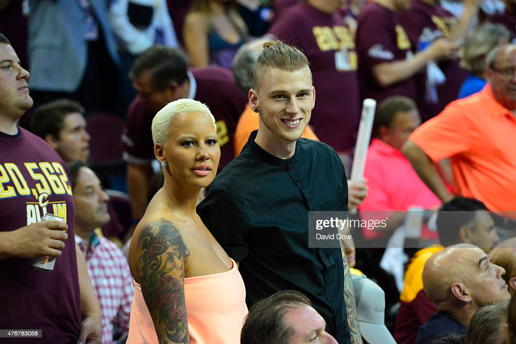Model Amber Rose and Rapper Machine Gun Kelly takes in the game of the Golden State Warriors against the Cleveland Cavaliers in Game Four of the 2015...