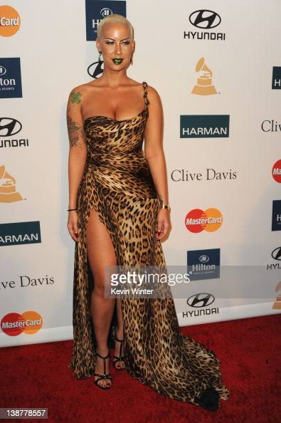Model Amber Rose arrives at Clive Davis and the Recording Academy's 2012 PreGRAMMY Gala and Salute to Industry Icons Honoring Richard Branson held at...