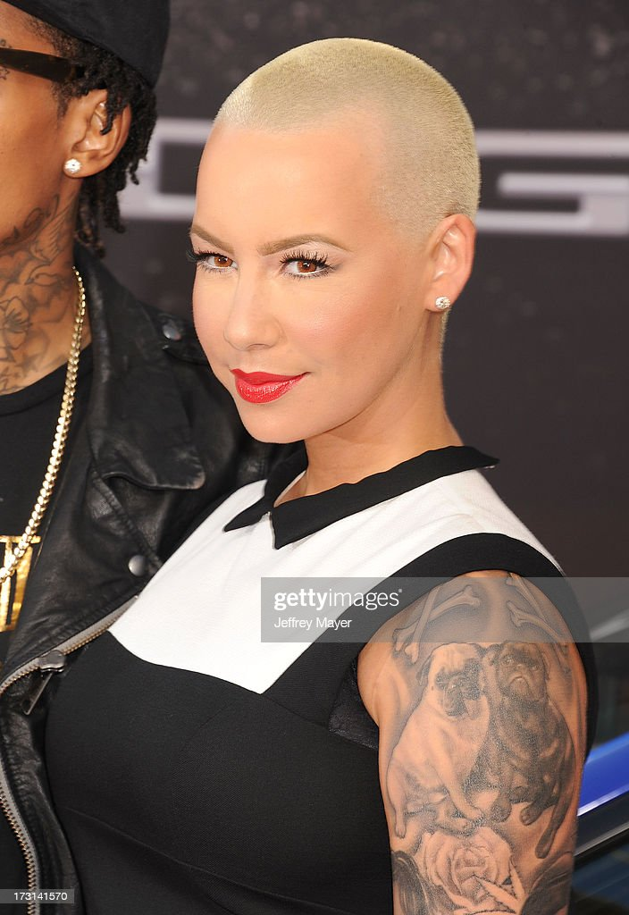 Model Amber Rose arrives at the 'Fast & The Furious 6' Los Angeles premiere at Gibson Amphitheatre on May 21, 2013 in Universal City, California.