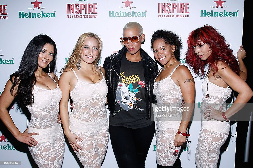 Model <a gi-track='captionPersonalityLinkClicked' href=/galleries/search?phrase=Amber+Rose+-+Model&family=editorial&specificpeople=2025513 ng-click='$event.stopPropagation()'>Amber Rose</a> poses for a photo with the Scarlet Fever at the Heineken Inspire Encore Event featuring Nas, Cee Lo Green, Diplo, Pete Rock, J. Cole and Roxy Cottontail at Basketball City - Pier 36 - South Street on November 13, 2010 in New York City.