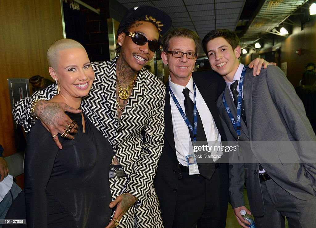 Model Amber Rose (L), rapper Wiz Khalifa (2nd from L) and guests attend the 55th Annual GRAMMY Awards at STAPLES Center on February 10, 2013 in Los Angeles, California.
