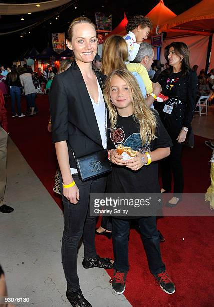 Model Amber Valetta and son Auden attend PS Arts Express Yourself 2009 at Barker Hangar at the Santa Monica Airport on November 15 2009 in Santa...