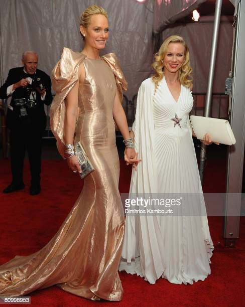 Model Amber Valletta and actress Naomi Watts depart the Metropolitan Museum of Art Costume Institute Gala 'Superheroes Fashion And Fantasy' at the...