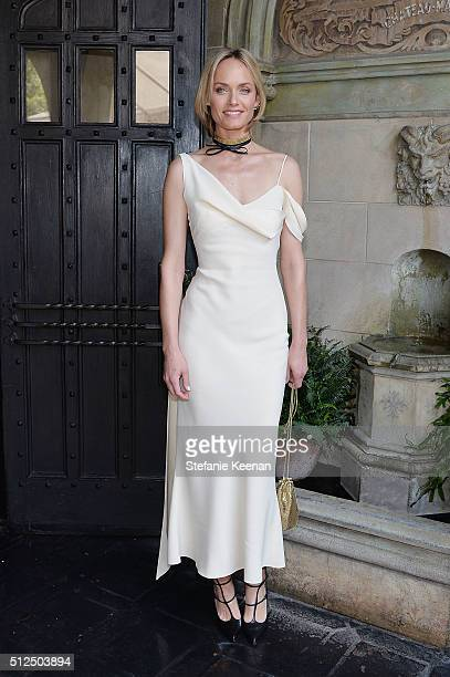 Model Amber Valletta attends NETAPORTER Celebrates Women Behind The Lens at Chateau Marmont on February 26 2016 in Los Angeles California
