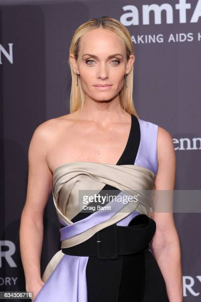Model Amber Valletta attends the amfAR New York Gala 2017 sponsored by FIJI Water at Cipriani Wall Street on February 8 2017 in New York City